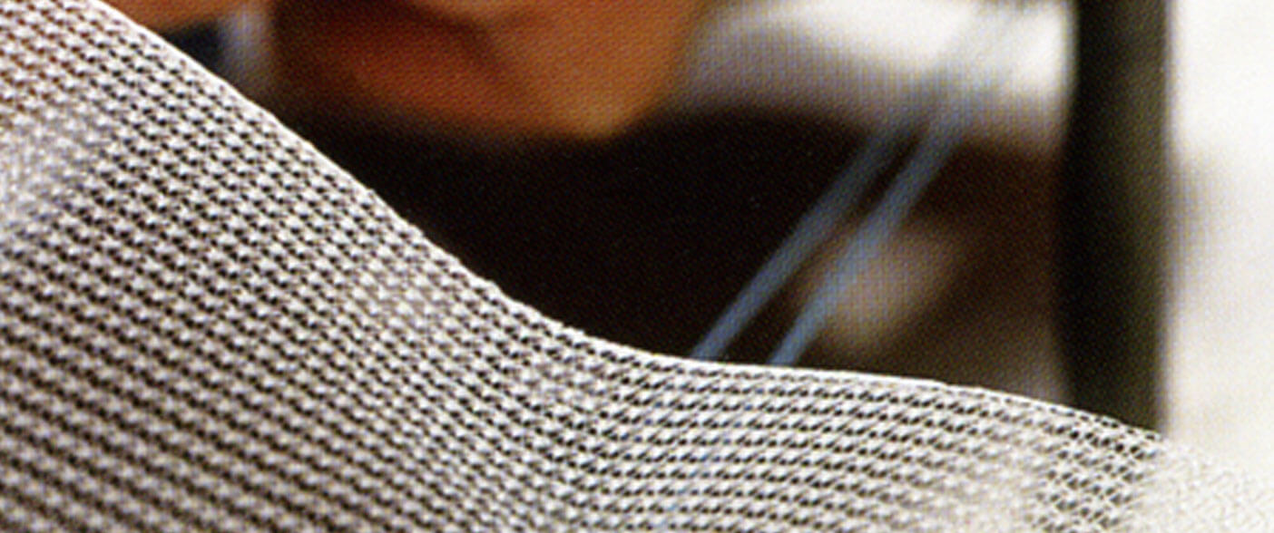Polypropylene medical mesh with an edge treatment that eliminates fraying, sharp edges, and particulate.