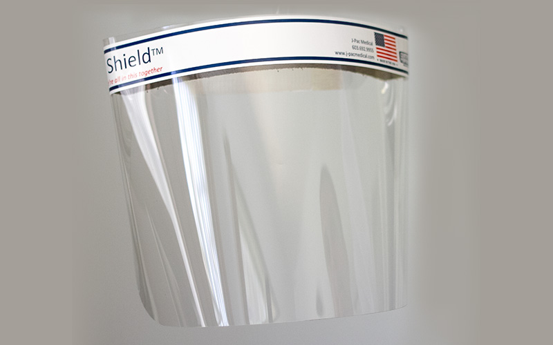 Front view of J-Pac's protective medical grade face shield showing the label and plastic visor.